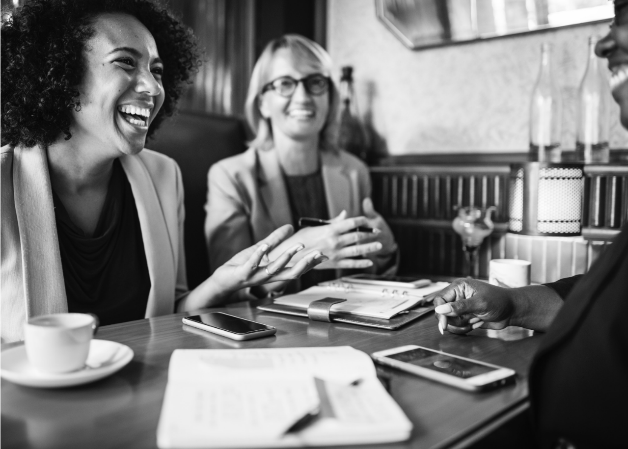 women laughing in boardroom